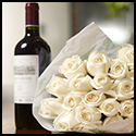 white roses bouquet, red wine bottle